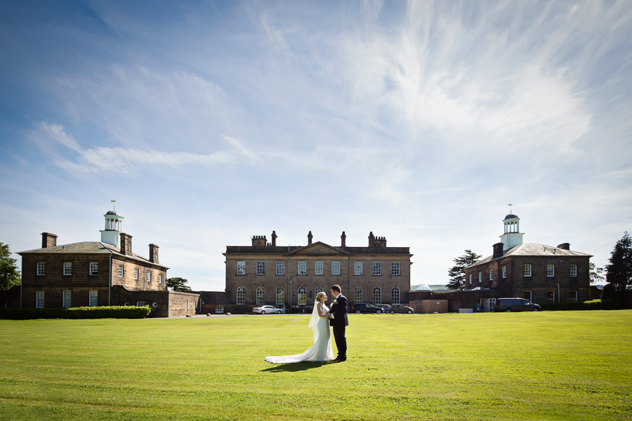 Denton Hall Wedding - couple in front of the venue
