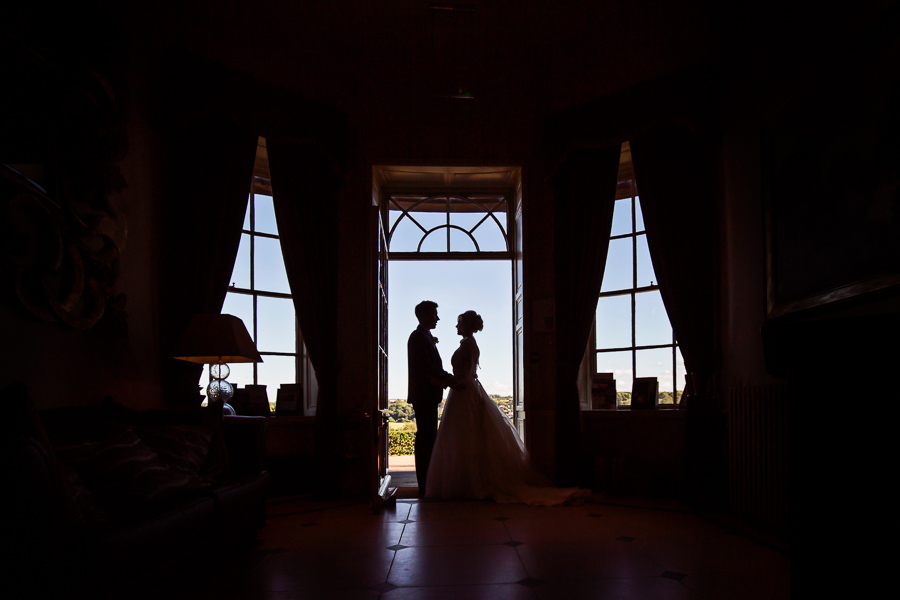 Wedding at Wood Hall - couple silhouette in the doorway