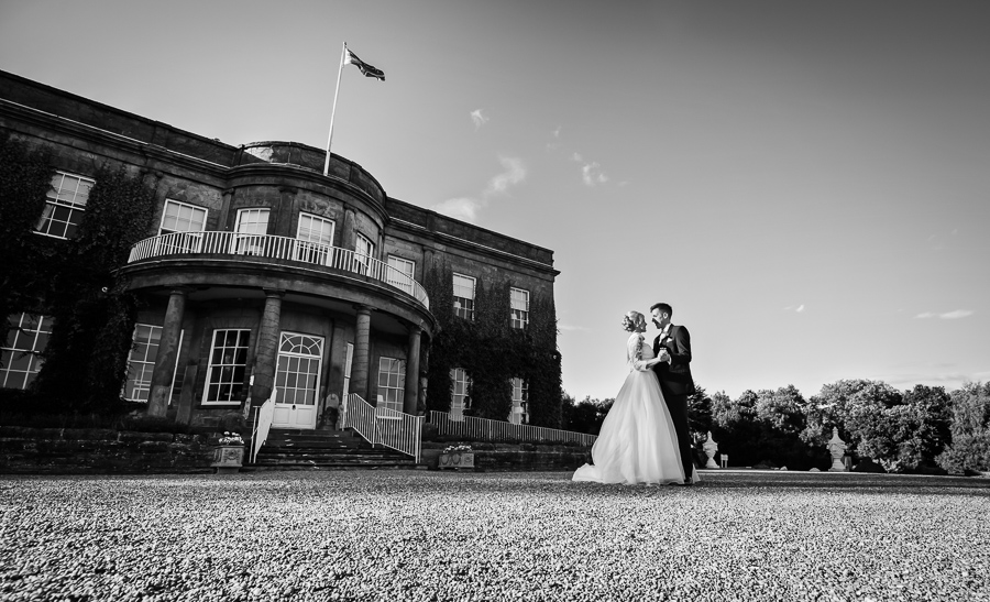 Wedding at Wood Hall - bride and groom in front of the venue