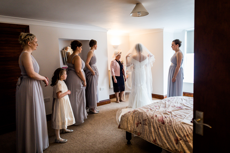 yorkshire wedding photographer - bridesmaids helping bride get ready