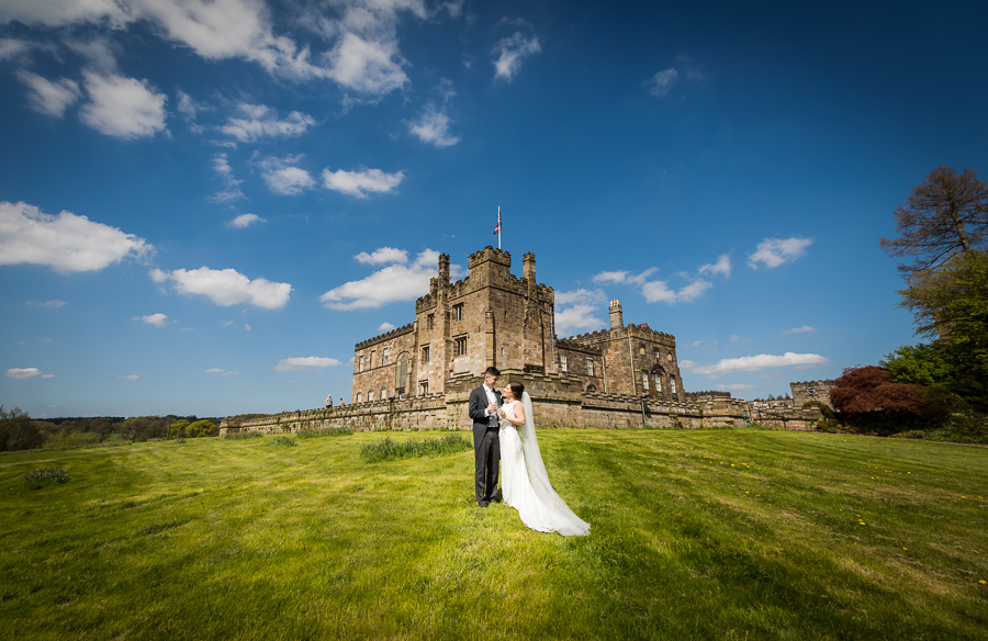 wedding couple in front of ripley castle