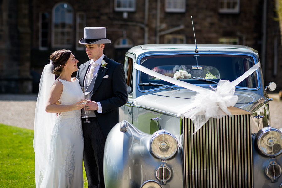 wedding car and couple at Ripley Castle
