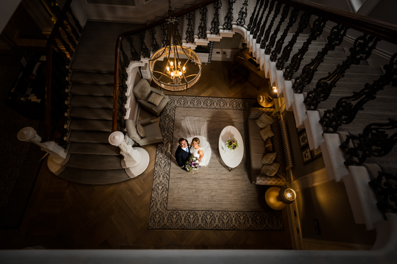The Principal Hotel York Wedding Photography - bride and groom below the staircase