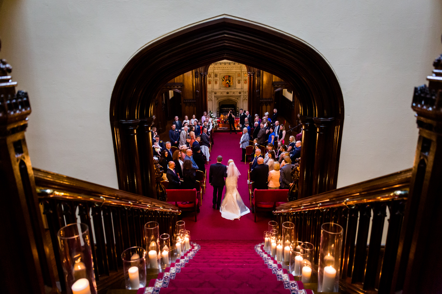 Allerton Castle Wedding Photography - Bride and her Dad walking down the grand staircase