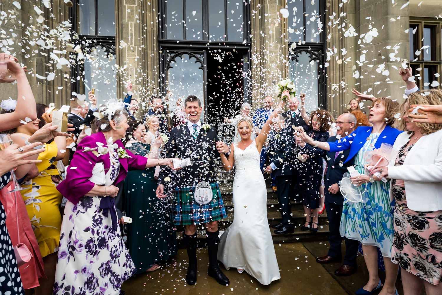 Allerton Castle Wedding Photography - couple being showered with confetti