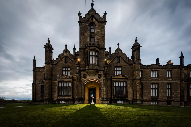 Allerton Castle Wedding Photography - couple portrait in the castle doors