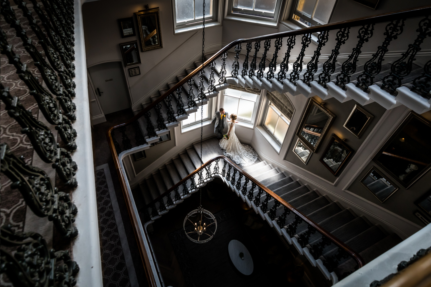 The Principal Wedding Photography - bride and groom on the grand staircase