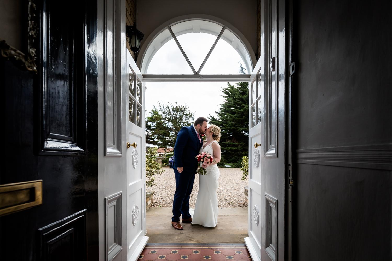 Dunedin House Wedding Photography - Couple portrait in the doorway