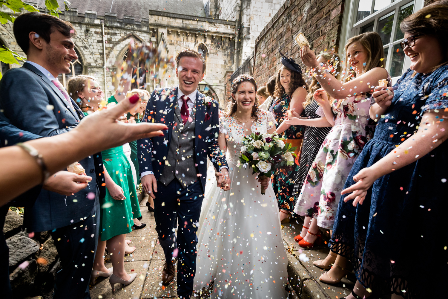 Principal Hotel York Wedding Photographer - Couple being showered with confetti