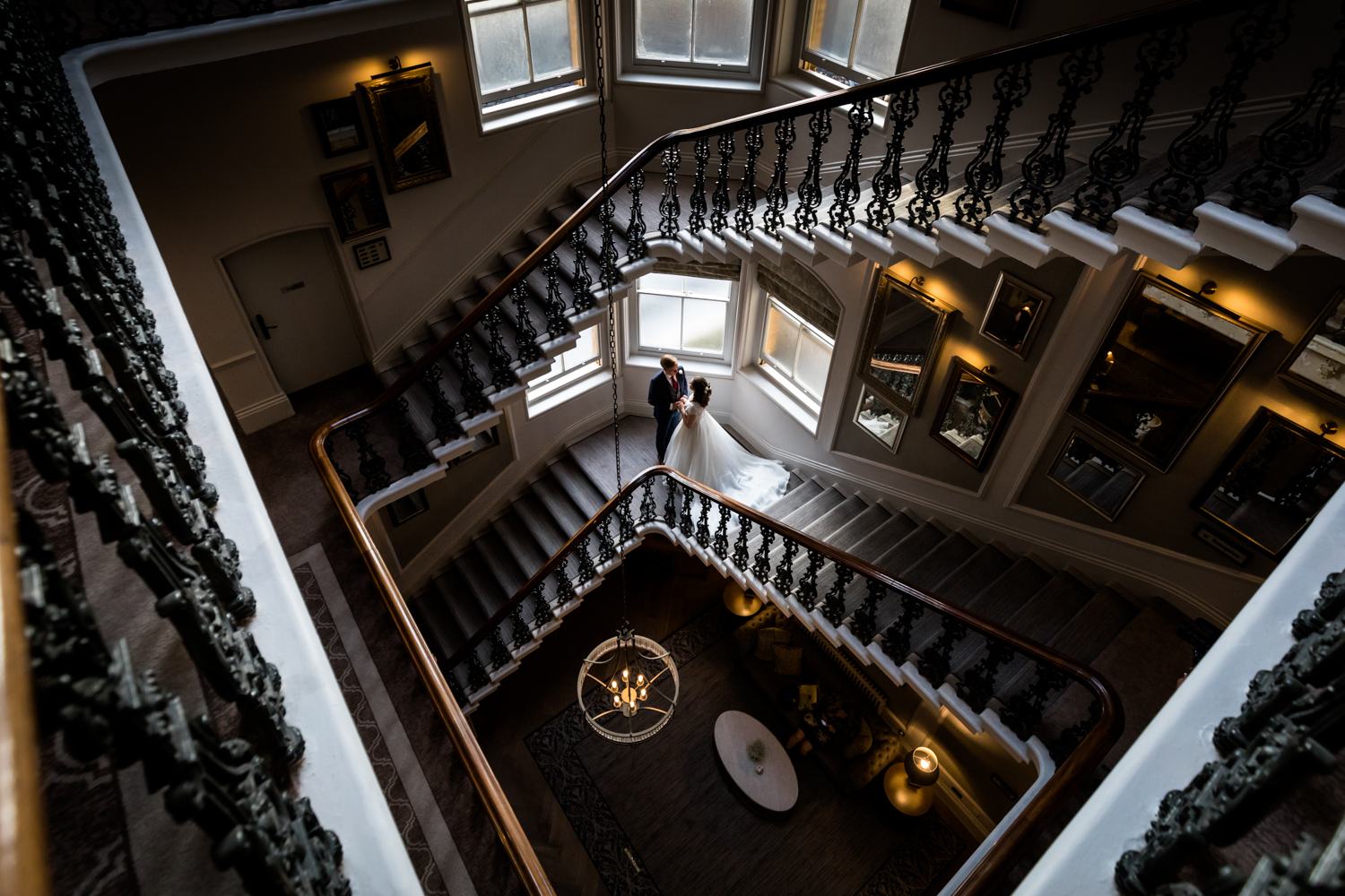 Principal Hotel York Wedding Photographer - bride and groom on the grand staircase
